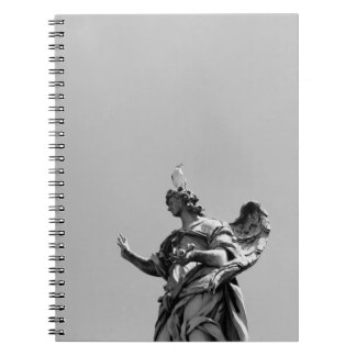 Simple, modern photo of seagull on top of statue spiral notebook