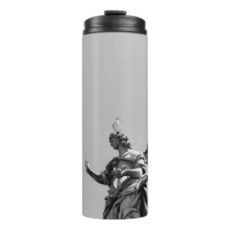 Simple, modern photo of seagull on top of statue thermal tumbler