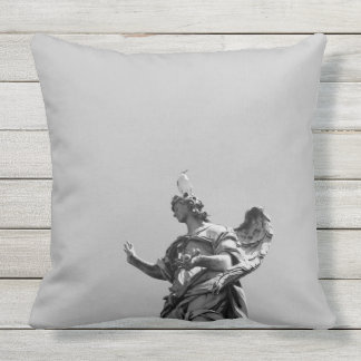 Simple, modern photo of seagull on top of statue throw pillow