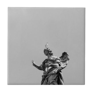 Simple, modern photo of seagull on top of statue tile