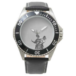Simple, modern photo of seagull on top of statue wristwatch