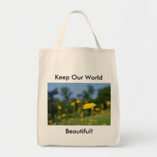 Single dandelion against the field grocery tote bag