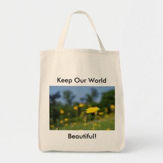 Single dandelion against the field tote bag