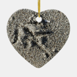 Single footprint of seagull bird on beach sand ceramic ornament