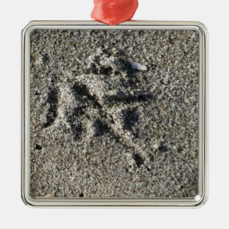 Single footprint of seagull bird on beach sand metal ornament