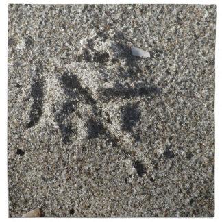 Single footprint of seagull bird on beach sand napkin