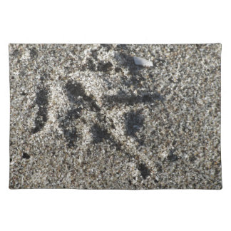 Single footprint of seagull bird on beach sand placemat