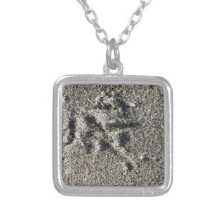 Single footprint of seagull bird on beach sand silver plated necklace