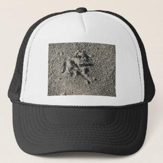 Single footprint of seagull bird on beach sand trucker hat