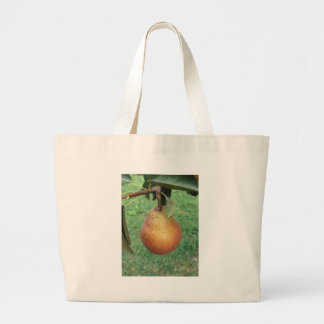 Single red pear hanging on the tree jumbo tote bag