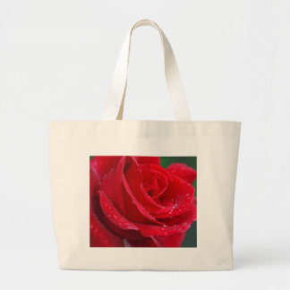 Single red rose blossoms large tote bag