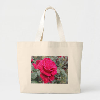 Single red rose flower with water droplets large tote bag