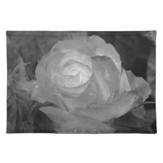 Single rose flower with water droplets in spring placemat