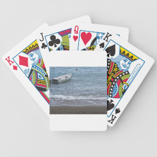 Single rowing boat moored in a harbor on the sea bicycle playing cards