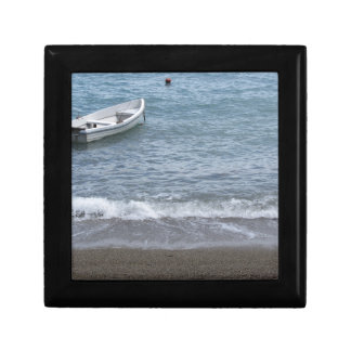 Single rowing boat moored in a harbor on the sea gift box