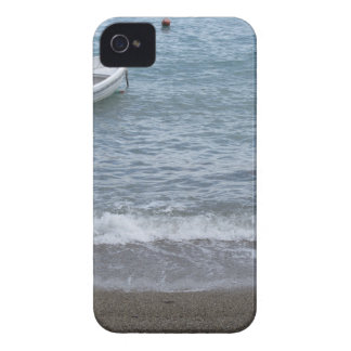 Single rowing boat moored in a harbor on the sea iPhone 4 cover