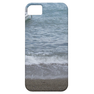 Single rowing boat moored in a harbor on the sea iPhone 5 cover