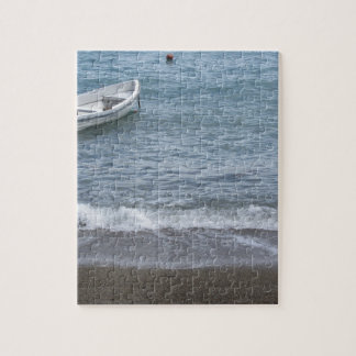 Single rowing boat moored in a harbor on the sea jigsaw puzzle