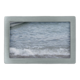 Single rowing boat moored in a harbor on the sea rectangular belt buckles