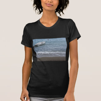 Single rowing boat moored in a harbor on the sea T-Shirt