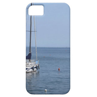 Single sailboat lies at anchor in a harbor case for the iPhone 5