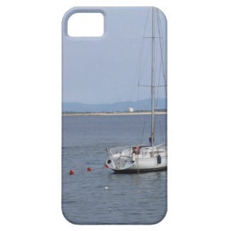 Single sailboat lies at anchor in a harbor iPhone 5 cover