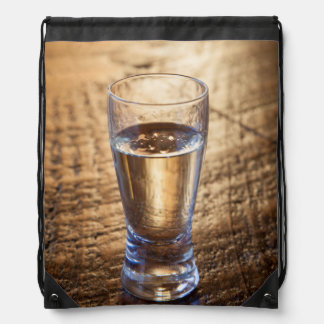 Single shot of Tequila on wood table Drawstring Backpack
