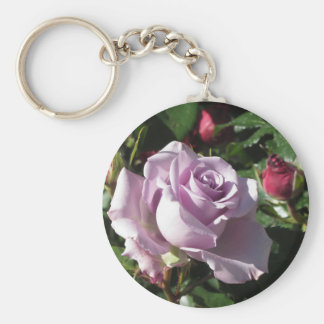 Single violet rose flower with red roses around basic round button keychain