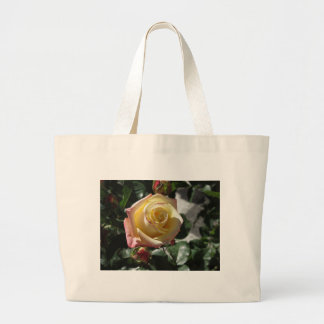 Single yellow rose flower in spring large tote bag
