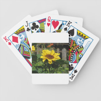 Single yellow sunflower with green leaves bicycle playing cards