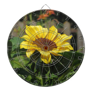 Single yellow sunflower with green leaves dartboard