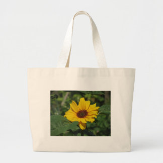 Single yellow sunflower with green leaves jumbo tote bag