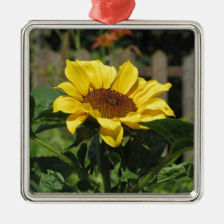 Single yellow sunflower with green leaves metal ornament