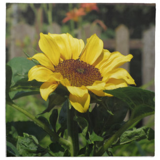 Single yellow sunflower with green leaves napkin