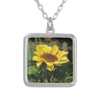Single yellow sunflower with green leaves silver plated necklace
