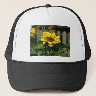 Single yellow sunflower with green leaves trucker hat