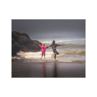 Sisters on a Foggy Morning at the Beach Canvas Print