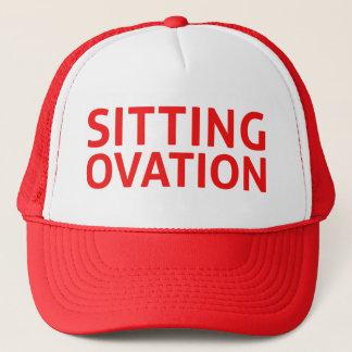 SITTING OVATION funny slogan trucker hat in red