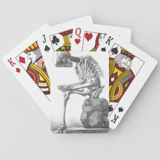 Sitting vintage skeleton thinking playing cards
