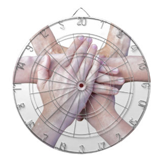 Six arms unite with hands on each other dartboard