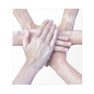 Six arms unite with hands on each other notepad
