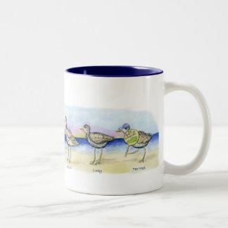 six sandpipers on a mug