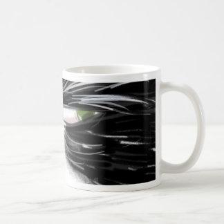 Skeptical cat close-up basic white mug