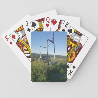 Ski lift chair in the summer playing cards