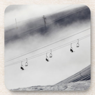 Skiers on a chair lift coaster