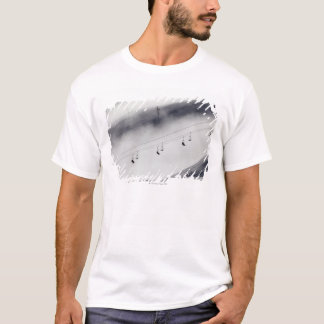 Skiers on a chair lift T-Shirt