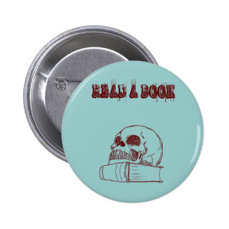 Skull and a book pinback button