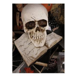 Skull On Book Postcard
