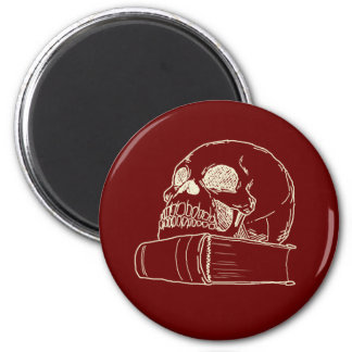 Skull with a book 2 inch round magnet