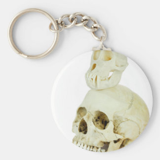 Skulls of human and ape on top basic round button keychain